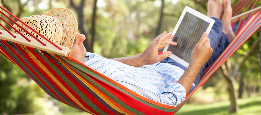 Reading on tablet in a hammock