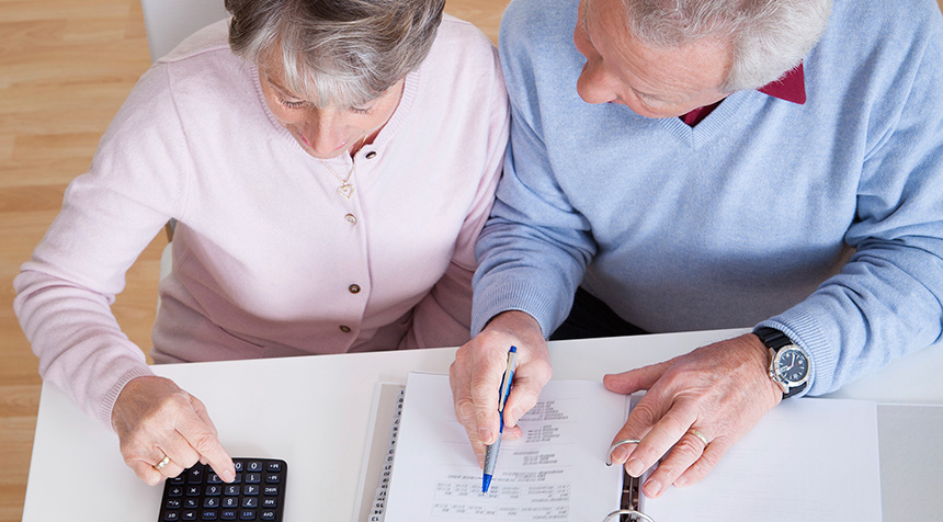 Elderly couple doing taxes together